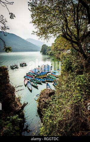 Colorful boats on Phewa Lake, Pokhara, Nepal - Stock Photo