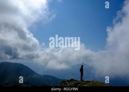Germany, Bavaria, Upper Bavaria, Bavarian Prealps, View from Wallberg, hiker standing on mountaintop - Stock Photo
