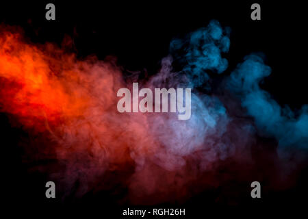 Collision of two streams of smoke with the transition of the colors of blue and red through the pigment molecules on a black background. - Stock Photo