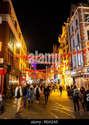London,UK - January 25th 2019: People Walking through China Town in London at night - Stock Photo