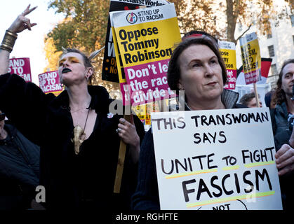 Transgender people marching against Tommy Robinson, racism and fascism. Anti-racism Anti-Fascism march and protest through central London on 17 Nov 2018 - Stock Photo