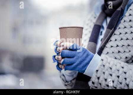 Close up of a paper glass in female hands Stock Photo
