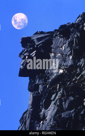The Old Man in the Mountain and a full moon (added).  Franconia Notch, NH, USA.  The rock formation collapsed May 3, 2003 - Stock Photo