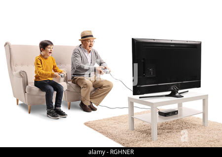 Grandfather and grandson playing video game in front of a TV isolated on white background - Stock Photo