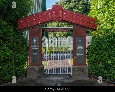 Gateway with Maori carving, Sacred Heart Catholic Church, Tolaga Bay, East Cape, North island, New Zealand - Stock Photo