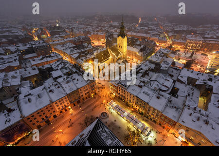 Lviv in winter time. Picturesque evening view on city center from top of town hall. Eastern Europe, Ukraine - Stock Photo