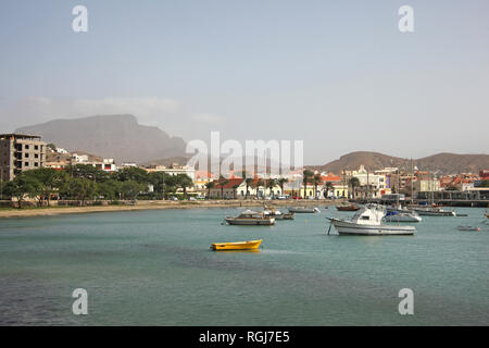 Harbor with fishing boats & the water front of Mindelo on Sao Vicente Island, Cape Verde Islands. - Stock Photo