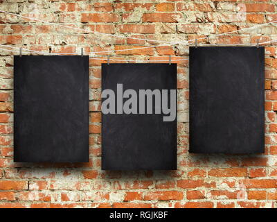 Three blank blackboard frames against orange brick wall background - Stock Photo