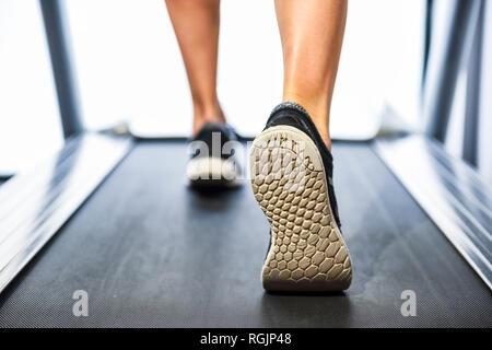 Person running on a treadmill