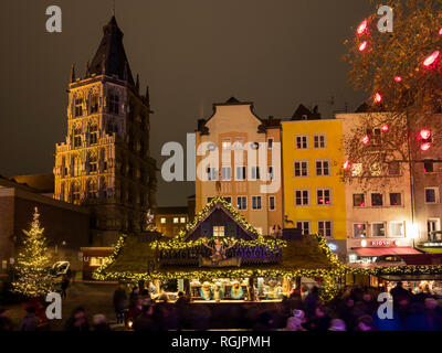Germany, Cologne, view to historic town hall and row of houses with Christmas market in the foreground - Stock Photo