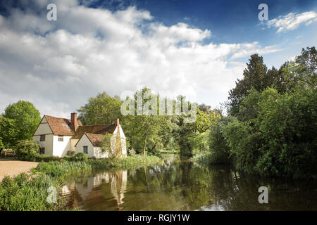 Contemporary view of Flatford Mill, the scene painted by John Constable in his painting 'The Hay Wain' in the Dedham Vale district of East England - Stock Photo