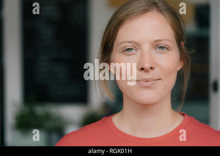 Portrait of confident young woman in a cafe