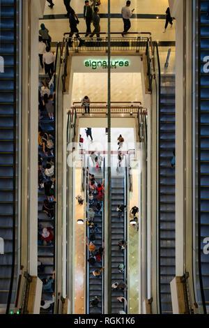 view of the escalators inside the Suria KLCC mall in Kuala Lumpur, Malaysia - Stock Photo