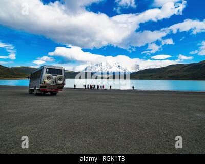Chile, Patagonia, Magallanes y la Antartica Chilena Region, Torres del Paine National Park, Cuernos del Paine, Tourists at Laguna Amarga - Stock Photo