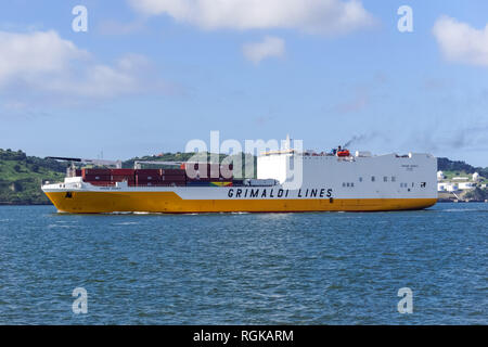 Cargo container ship Grimaldi Lines on the river Tagus in Lisbon, Portugal - Stock Photo