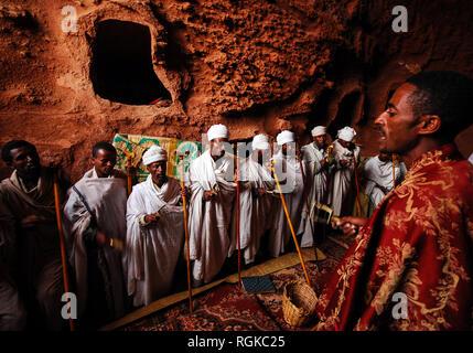 Lalibela, Ethiopia, 14th June 2009: Group of priests chanting prayers inside rock hewn church - Stock Photo