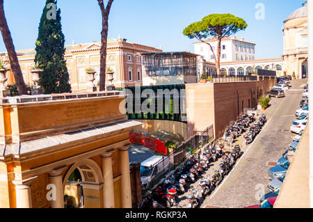 Vatican, Rome, Italy - November 16, 2018: Parking for mopeds and cars inside the territory of Vatican museums in Rome, Italy - Stock Photo
