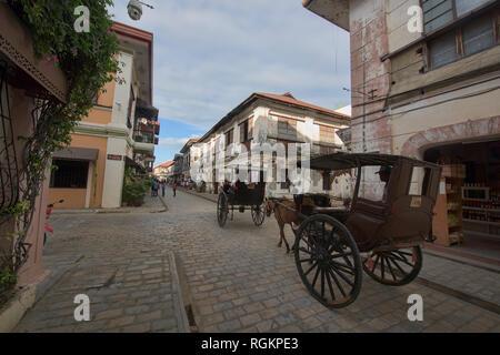 Kalesa horse carriages on historic Calle Crisologo, Vigan, Ilocos Sur, Philippines - Stock Photo