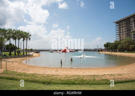 Darwin, Northern Territory, Australia-October 8,2017: Waterfront lagoon and obstacle course with people in Darwin, Australia - Stock Photo