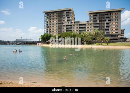 Darwin, Northern Territory, Australia-October 8,2017: Lagoon swim on the waterfront with apartment buildings in Darwin, Australia - Stock Photo