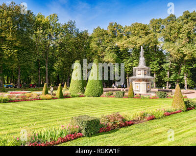 18 September 2018: St Petersburg, Russia - Peterhof Palace Gardens, with topiary and Wedding Cake Fountain. - Stock Photo