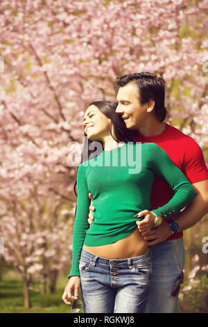 Young stylish couple in park - Stock Photo