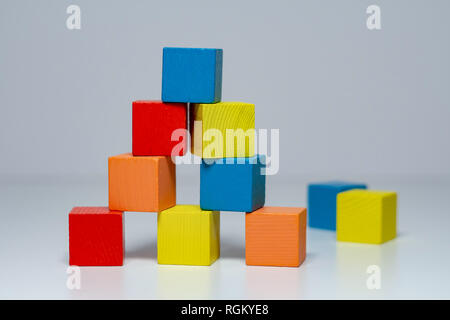 Building from wooden colourful childrens blocks - Stock Photo