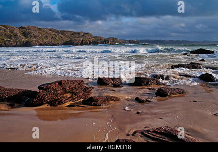 Stormy sky and rough sea, rocks on beach, dramatic light, wild weather, Oldshoremore Bay, Sutherland, Scottish Highlands, Scotland UK - Stock Photo