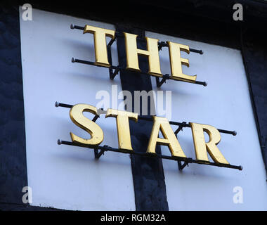 A sign on a public house or pub or Inn saying 'The Star' - Stock Photo