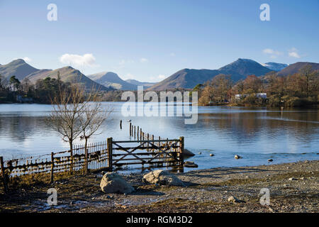 Derwentwater and the Western Fells seen from Keswick on a sunny winter day, clear blue sky, Lake District, Cumbria, England UK. - Stock Photo