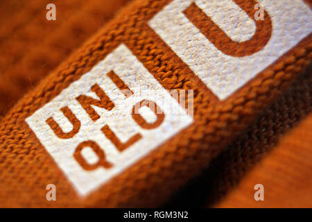 Logo printed on clothes by Japanese retailer Uniqlo, close-up - Stock Photo