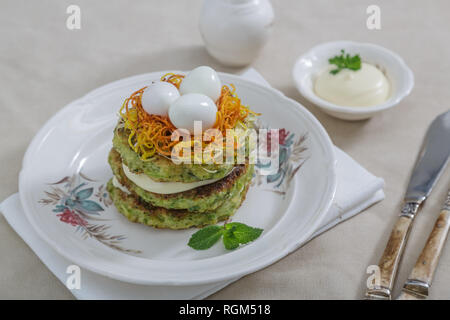 Healthy breakfast with zucchini fritters and eggs - Stock Photo