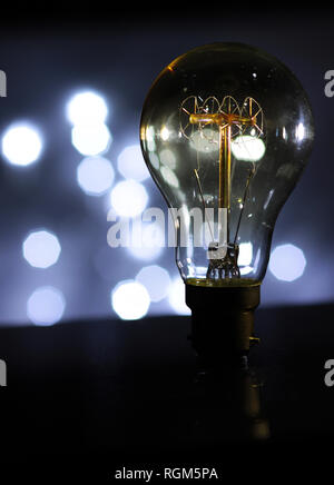 Antique light bulb with bokh background - Stock Photo