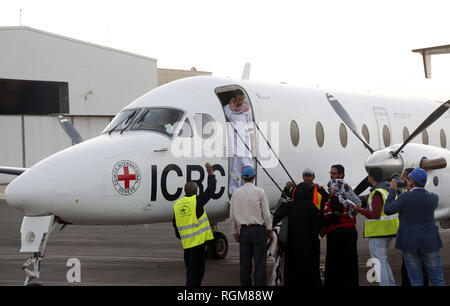 Sanaa, Yemen. 29th Jan, 2019. Musa Awagi boards a plane of the International Committee of the Red Cross (ICRC) after he was released by the Houthi rebels at the Sanaa International Airport, in Sanaa, Yemen, on Jan. 29, 2019. Yemen's Houthi rebels on Tuesday handed over a captured Saudi soldier to the ICRC, the rebels said in a statement. 'The sick Saudi soldier Musa Awagi will be transported to his country through an ICRC plane today (Tuesday),' the statement said. Credit: Mohammed Mohammed/Xinhua/Alamy Live News - Stock Photo