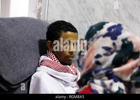 Sanaa, Yemen. 29th Jan, 2019. Musa Awagi waits to be transported at the Sanaa International Airport, in Sanaa, Yemen, on Jan. 29, 2019. Yemen's Houthi rebels on Tuesday handed over a captured Saudi soldier to the International Committee of the Red Cross (ICRC), the rebels said in a statement. 'The sick Saudi soldier Musa Awagi will be transported to his country through an ICRC plane today (Tuesday),' the statement said. Credit: Mohammed Mohammed/Xinhua/Alamy Live News - Stock Photo