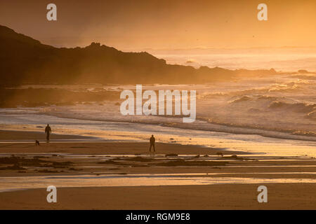 Mumbles, Swansea, UK. 30th January, 2019. People out walking making the most of the sunrise at Langland Bay today near Swansea on the start of a frosty winters morning. Credit: Phil Rees/Alamy Live News - Stock Photo
