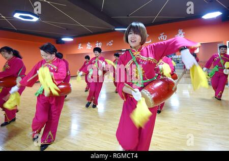 Shijiazhuang, China's Hebei Province. 30th Jan, 2019. Trainees rehearse waist drum dance at a cultural center in Nanhe County, north China's Hebei Province, Jan. 30, 2019. More than 2000 people have participated in art training programs at a cultural center in Nanhe County as a way to enrich their life. Credit: Zhu Xudong/Xinhua/Alamy Live News - Stock Photo