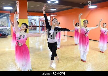 Shijiazhuang, China's Hebei Province. 30th Jan, 2019. A dance instructor (C) and trainees rehearse dance at a cultural center in Nanhe County, north China's Hebei Province, Jan. 30, 2019. More than 2000 people have participated in art training programs at a cultural center in Nanhe County as a way to enrich their life. Credit: Zhu Xudong/Xinhua/Alamy Live News - Stock Photo