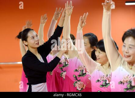 Shijiazhuang, China's Hebei Province. 30th Jan, 2019. A dance instructor (1st L) and trainees practice dancing at a cultural center in Nanhe County, north China's Hebei Province, Jan. 30, 2019. More than 2000 people have participated in art training programs at a cultural center in Nanhe County as a way to enrich their life. Credit: Zhu Xudong/Xinhua/Alamy Live News - Stock Photo