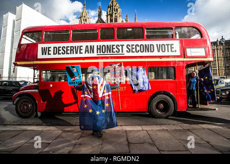 London, UK. 30th Jan, 2019. Brexit protestors outside Houses of Parliament, Whitehall London, UK. 30th Jan, 2019. England, United Kingdom Anti-Brexit protesters looking for a people's vote drive a double-decker bus past the Houses of Parliamnet whilst the UK Prime Minister Theresa May has now got to re-negotiate the terms of Britan leaving the EU and find away around the Irish backstop. Credit: Jeff Gilbert/Alamy Live News - Stock Photo
