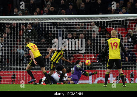 London, UK. 30th Jan, 2019. Craig Cathcart of Watford (15) scores his team's first goal. EPL Premier League match, Tottenham Hotspur v Watford at Wembley Stadium in London on Wednesday 30th January 2019. this image may only be used for Editorial purposes. Editorial use only, license required for commercial use. No use in betting, games or a single club/league/player publications . pic by Steffan Bowen/Andrew Orchard sports photography/Alamy Live news Credit: Andrew Orchard sports photography/Alamy Live News - Stock Photo