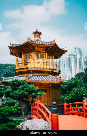 China, Hong Kong, Nan Lian Garden, Golden Pavilion of Absolute Perfection surrounded by skyscrapers