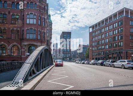 Germany, Hamburg, Speicherstadt, Building of Hamburger Hafen und Logistik AG left - Stock Photo