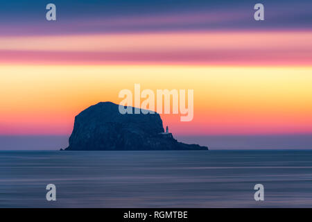 Great Britain, Scotland, East Lothian, North Berwick, Firth of Forth, view of Bass Rock at sunrise, lighthouse - Stock Photo