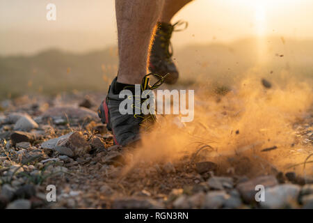 Close-up of feet of a trail runner - Stock Photo