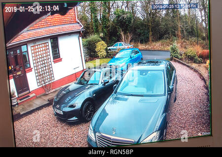 Monitor showing CCTV Camera surveillance from Multiple DVR Locations around a home and gardens at a private home in England - Stock Photo