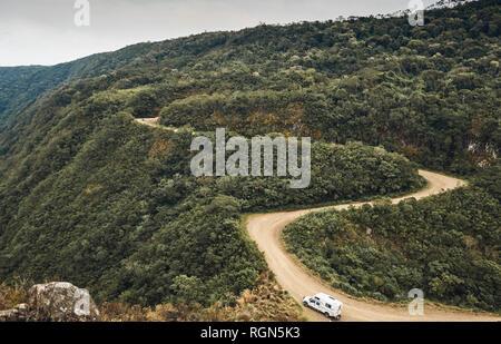 Brazil, Aparados da Serra, caravan on gravel road - Stock Photo