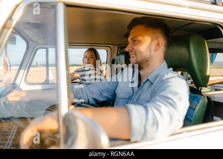 Young couple on a trip in camper van - Stock Photo