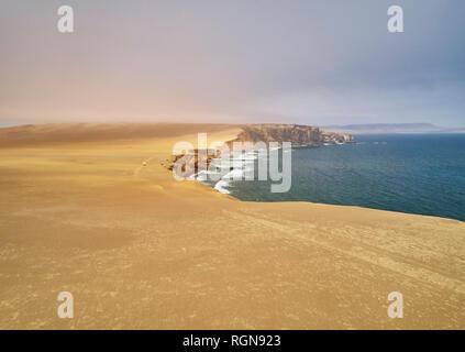Peru, Paracas, camper at cliff coast in National Park Paracas - Stock Photo