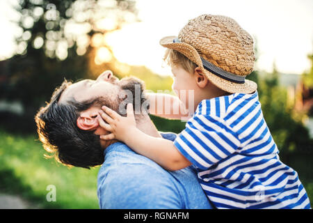 Little boy having fun with his father outdoors